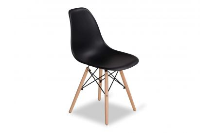 Angled shot of black modern chair with light-coloured wooden legs Kuga