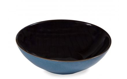 Angled shot of the Sierra blue soup bowl with black on the inside
