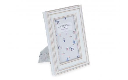 Angled shot of 6x4 photo frame Seaside with a white wooden frame with a distressed painted background and a nautical theme