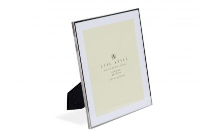 Angled shot of the elegant and chic Laurel 8x10 inch white metal photo frame with silver plated edges and black back