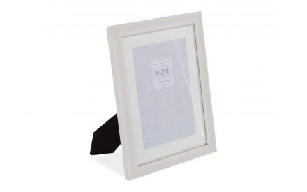 Angled shot of the Home Collection small 6x4 inch cream wooden photo frame with a black strut