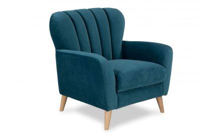 Angled shot of the Harper green velvet armchair with four light wooden feet