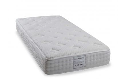 An angled shot of the 6 ft Natural Comfort super king  roll up mattress.