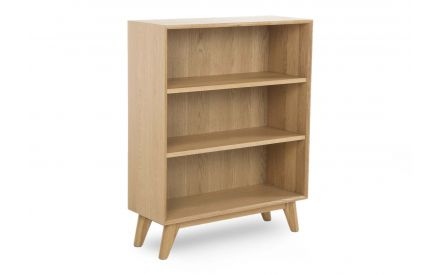 A low oak bookcase with 3 shelves from EZ Living Furniture's Rho range. Angled view.