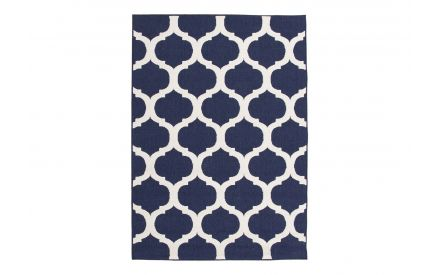 A view of the top part of the Amelle cream and blue rug