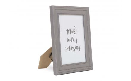 A 8 x 10 Taupe Photo frame with thick edges from EZ Living Furniture's Osman range. Angled view of frame on stand