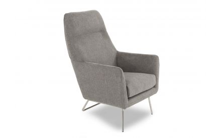 Maisie Grey Fabric Armchair in a power image taken from an angle showing metal frame legs and rich cushioned fabric