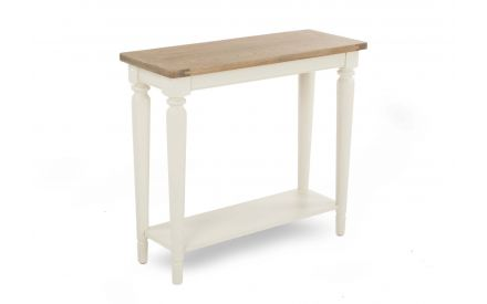 A console table in cream with an oak top and 1 shelf from EZ Living Furniture's Farmhouse range. Angled view.