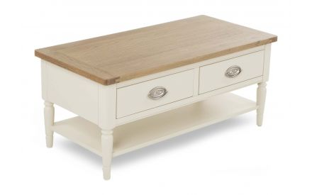 A cream coffee table with 2 drawers