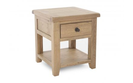 A smoked oak lamp table with a shelf & drawer from EZ Living Furniture's Country Cottage range. Angled view shows shelf