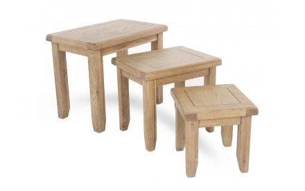 A set of 3 nest of tables in Smoked Oak from EZ Living Furniture's Country Cottage range. Angled view of 3 sizes