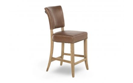 An oak bar stool with tan leather covered seat and back from EZ Living Furniture's Athy range. Angled view.