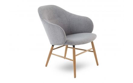 A lounge chair with oak legs & light grey fabric seat from EZ Living Furniture's Teno range. Angled view of curved arms
