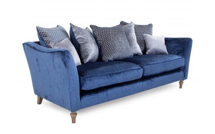 A 4 seater blue fabric pillowback sofa with 7 cushions from EZ Living Furniture's Sophia range. Angled view of wood feet.