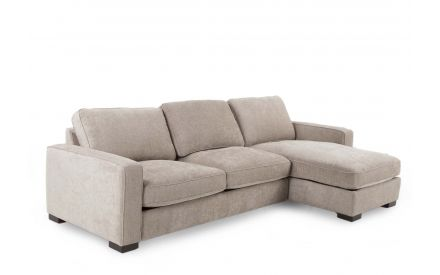 A 3 seater LAF corner chaise with mink fabric and dark feet from EZ Living Furniture's Darwin range. Angled view of chaise.