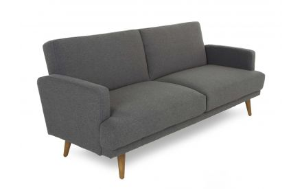 A dark grey fabric 3 Seater sofa bed with wood feet from EZ Living Furniture's Grant range. Angled view as sofa.