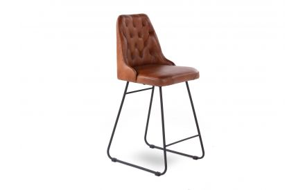 A tan brown leather bar stool with black metal frame from EZ Living Furniture's Gus range. Angled view of the side support se