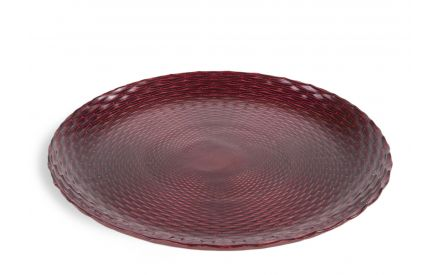 A red glass decorative plate with embossed design from EZ Living Furniture's Christmas glassware. Angeld view.