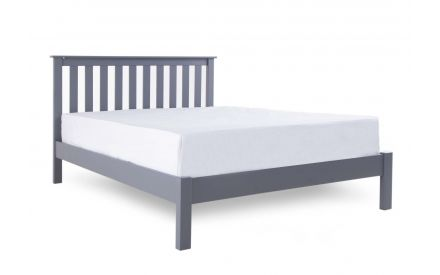 A grey pine wood 4ft 6 double bed frame from EZ Living Furniture's Atlas range. Angled view of bed with mattress