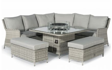 A grey rattan corner set with 2 benches