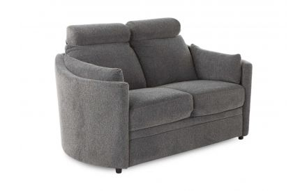 A grey fabric 2 seater curved sofa from EZ Living Furniture's Dunloe range. Angled view of high headrests.