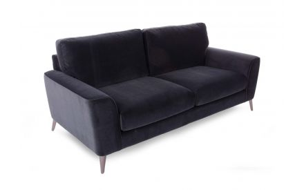 A 3 seater grey velvet sofa with chrome legs from EZ Living Furniture's Megan range. Angled view of sofa cushions