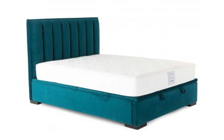 A 6ft teal velvet ottoman bed from EZ Living Furniture's Liberty range. Angled view of bed with mattress.