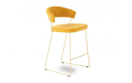 A yellow fabric seat & back  bar stool from EZ Living's New York range. Angled view of brass frame.
