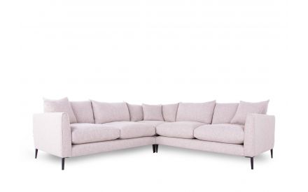 A lush cream fabric corner sofa from EZ Living Furniture's Hunter range. Angled view of 3 scatter cushions.