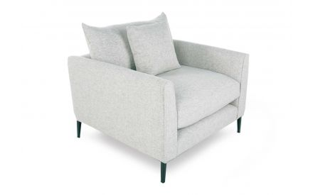 A cream fabric foam armchair with 1 scatter cushion from EZ Living Furniture's Hunter Range. Angled view of armchair