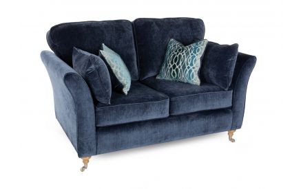 A navy blue fabric 2 seater sofa from EZ Living Furniture's Coolmore range. Angled view of 2 navy & 2 accent teal cushions