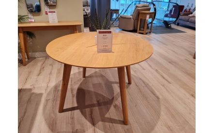 Actual look of the Rho round dining table floor model on offer in Fonthill store