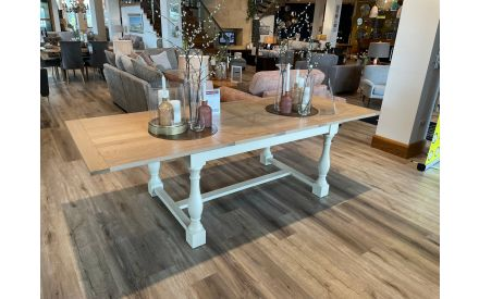 Actual Angled shot of the Chartreuse rustic two-tone large extendable dining table crafted with oak on offer in Limerick store