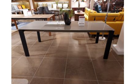 Actual look of the Eminence table glass top floor model on offer in City East store