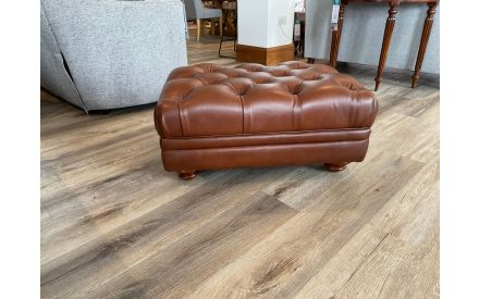 Actual brown leather footstool angled view on offer in Limerick store